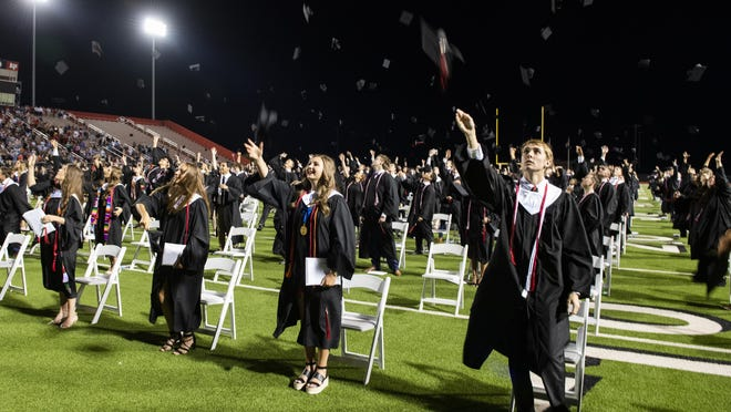 Lubbock-Cooper graduates toss their caps in the air to celebrate their graduation at the Lubbock-Cooper High School 2020 graduation on Friday, June 5, 2020, at Pirate Stadium in Woodrow, Texas.