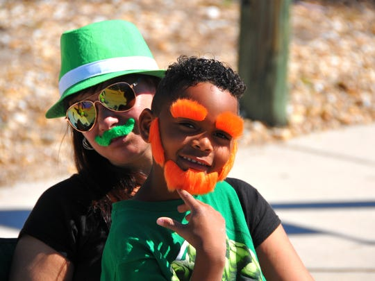 Andrea and Ion Cole from Palm Bay dressed for the parade. Hundreds, most of them dressed in green, lined the streets of downtown Melbourne Saturday morning for the 2017 Melbourne St. Patrick's Day Parade.