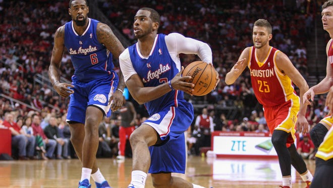 Los Angeles Clippers guard Chris Paul (3) drives the ball during the third quarter against the Houston Rockets at Toyota Center.