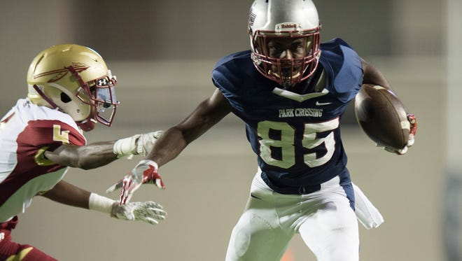 Park Crossing's Johnny George (85) avoids a tackle attempt by Russell County's Jalan Harbour (4) during the AHSAA football game at Cramton Bowl on Thursday, Sept. 15, 2016, in Montgomery, Ala.