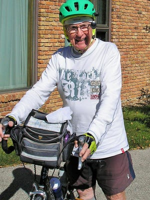 Still biking strong as he approaches his 90th birthday later this month, longtime Iowa City physician Dr. Oscar Beasley is shown at a friend's house in Lone Tree as he approached the end of a day-long, 90-mile birthday bike ride.