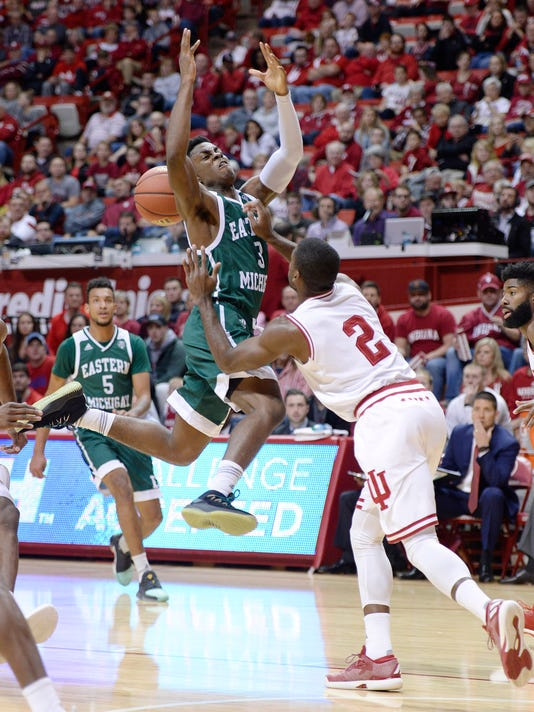 Indiana guard Josh Newkirk (2) fouls Eastern Michigan guard Paul Jackson (3) during an NCAA college basketball game in Bloomington, Ind., Friday, Nov. 24, 2017. (Chris Howell/The Herald-Times via AP)