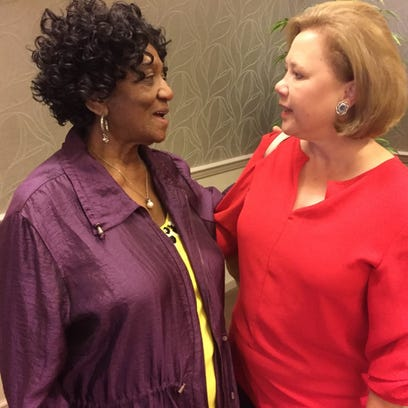 Billye Burns of West Monroe (left), chats with former