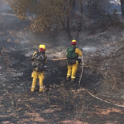 Firefighters battle the Bogart Fire on Tuesday, August