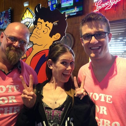 Molly Schuyler is flanked by D.J. Bacon (left) and