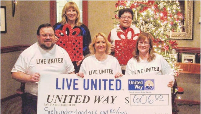 "Progressive Investors ""Live United"" by donating proceeds raised through their gift certificate sales for the 2014 United Way Community Campaign. The check presentation included, from front left: Brian Fauska, Friar Tuck's restaurant manager; Judy Summerfeldt, Sebastian's Steak House restaurant manager; Netti McAuther, Salty's Seafood & Spirits restaurant manager. Back left: Marcia Snyder, United Way campaign manager and Tina Potter, United Way executive director."