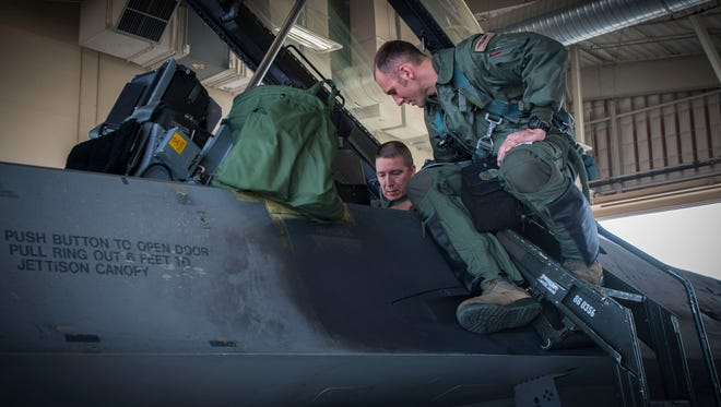 Maj. Brent Ellis, a fighter pilot with the 311th Fighter Squadron, instructs Brig. Gen. Eric Sanchez, the Commanding General at White Sands Missile Range, on basic flight procedures prior to a familiarization flight in an F-16 Fighting Falcon, at Holloman Air Force Base, N.M., on Jan. 9, 2017. Sanchez visited Holloman AFB to attend an airspace and mission brief related to Holloman and WSMR's ongoing partnership. Sanchez was offered a flight in an F-16 Fighting Falcon to gain a better understanding of the aircraft's mission and its capabilities.