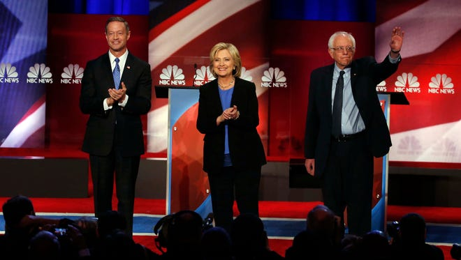 Martin O'Malley, Hillary Clinton and Bernie Sanders stand together before the start of the Democratic presidential debate at the Gaillard Center on Jan. 17, 2016, in Charleston, S.C.
