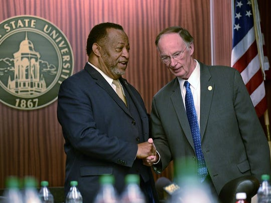 Elton Dean, left, former Alabama State University board of trustees chairman, greets Gov. Robert Bentley before a board meeting in 2013. Dean stepped down at Bentley's request and former trustee Marvin Wiggins was removed by the governor.