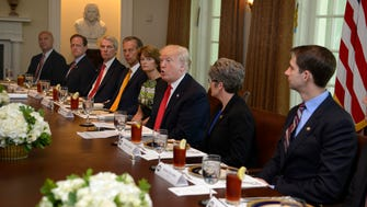 President Trump hosts a working lunch with Republican lawmakers to discuss the Senate health care bill on June 13, 2017.