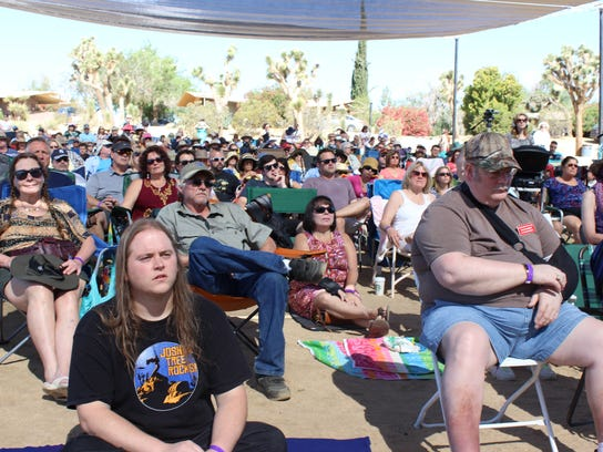 Contact in the Desert attendees listen to an panel