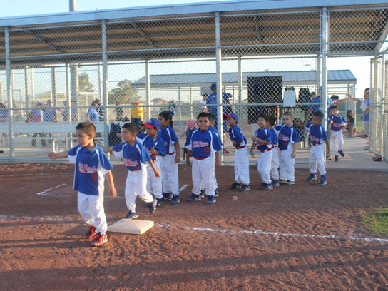 Little Rascals line-up to shake hands and show good sportsmanship