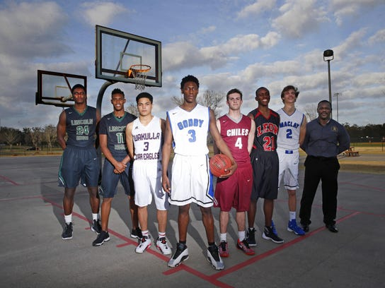 The 2016 boys basketball All-Big Bend first team. From left: Defensive Player of the Year Dwight Wilson (Lincoln), Kyle Kincey (Lincoln), Austin Everheart (Wakulla), Player of the Year Quan Jackson (Godby), Brett Easterling (Chiles), Trejan Davis (Leon), Kyle McWilliams (Maclay), Coach of the Year Dimitric Salters; Not pictured: Maurice Howard (Rickards)