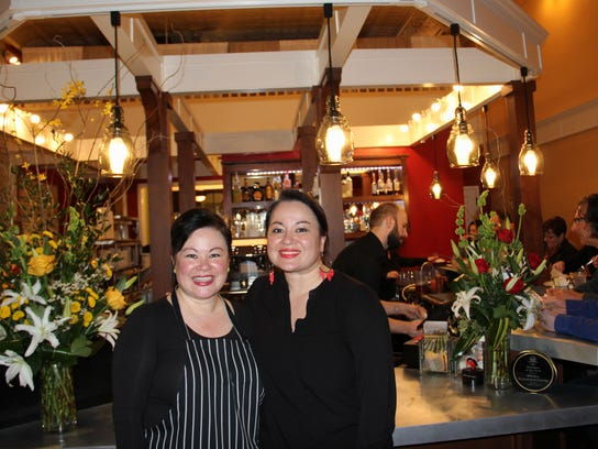 Jessica Ritter (left) and Cecilia Ritter James, co-owners of the Wild Pear Restaurant & Catering, opened the Wild Pear Restaurant & Catering more than fifteen years ago. Since then, both sisters have opened separate restaurants: Ritter James opened ACME Cafe with her husband, Jeff James, and Jessica Ritter opened Ritter's with her brother, Mike Ritter.
