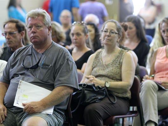 Tom Porter, a Sandy victim of Toms River, attends a
