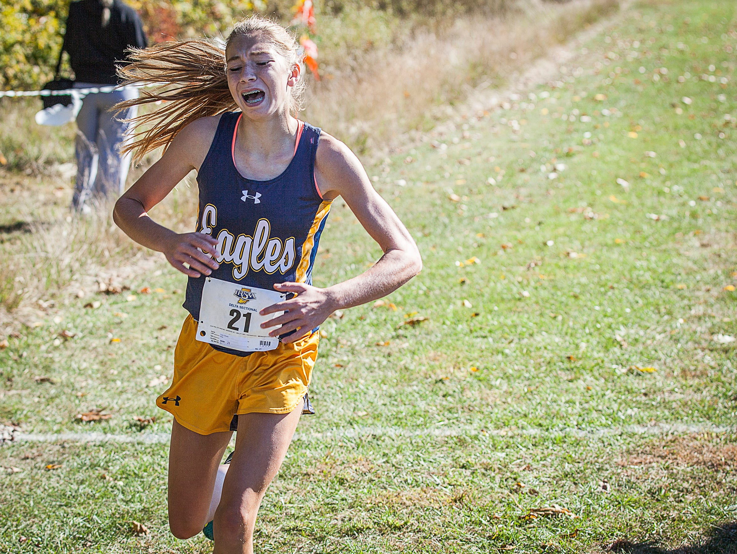 Brandy Tuttle finishes for Delta during the cross country sectional at the Sportsplex in Muncie on Saturday, Oct. 10, 2015.