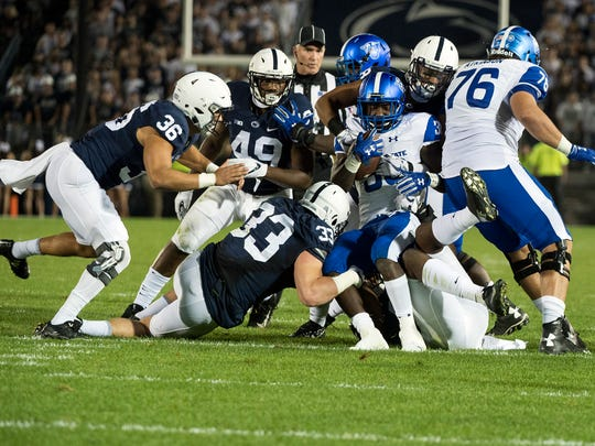 A group of Penn State defensemen tackle Georgia State's Demarcus Kirk, Saturday, September 16, 2017. The Nittany Lions beat the Panthers, 56-0.