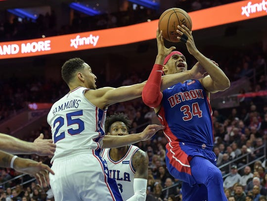Pistons forward Tobias Harris (34) is fouled by 76ers