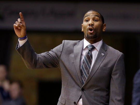 Butler Bulldogs head coach LaVall Jordan calls in a play to his players in the first half of their game at Hinkle Fieldhouse Wednesday, December 19, 2017.