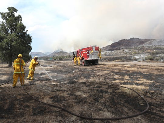 Firefighters from McCloud Fire Station put out hotspots