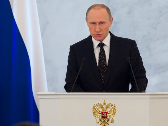 Russian President Vladimir Putin gives his annual state