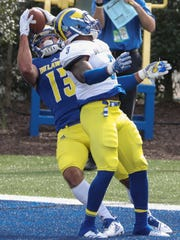 Delaware receiver Vinny Papale pulls in the game's