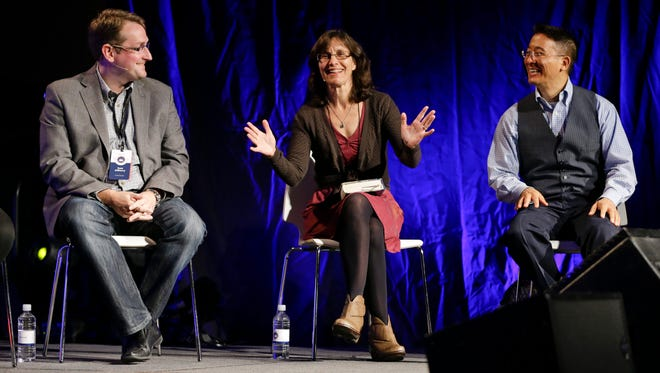 Panelists take part in a discussion during the Ethics and Religious Liberty Commission National Conference on Tuesday, Oct. 28, 2014, in Nashville, Tenn. From left are Sam Allberry, associate pastor of St. Mary's Maidenhead, in Berkshire, England, Rosaria Butterfield, and Christopher Yuan. Southern Baptists organized the three-day event to strengthen the resolve of Christians preaching the increasingly unpopular view that gay relationships are sinful. (AP Photo/Mark Humphrey)