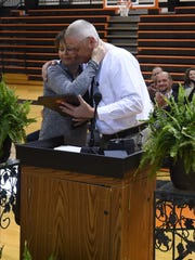Calico Rock special education supervisor Connie Moser (left) gets a hug from Superintendent Jerry Skidmore on Friday. Moser was presented with the Rural Education Association's Teacher of the Year award Friday.