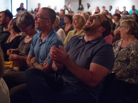 The audience laughs at Clifton Gray's story at the