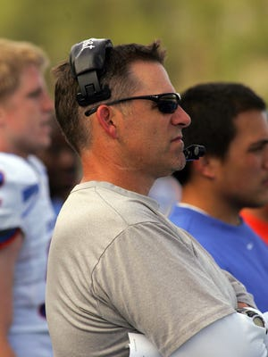 Washington defensive coordinator Pete Kwiatkowski, shown during his days at Boise State, received a raise to $875,000 annually, the most ever paid to a Huskies assistant coach.