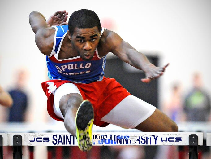 Apollo's Isaiah West clears the last hurdle to finish first in his heat of the 55-meeter hurdles during the Sartell Invitational track meet at St. John's University Saturday.