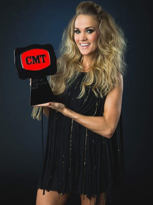 Winner of 'Video of the Year', Carrie Underwood poses at the 2014 CMT Music Awards - Wonderwall Portrait Studio at Bridgestone Arena on June 4, 2014 in Nashville, Tennessee.
