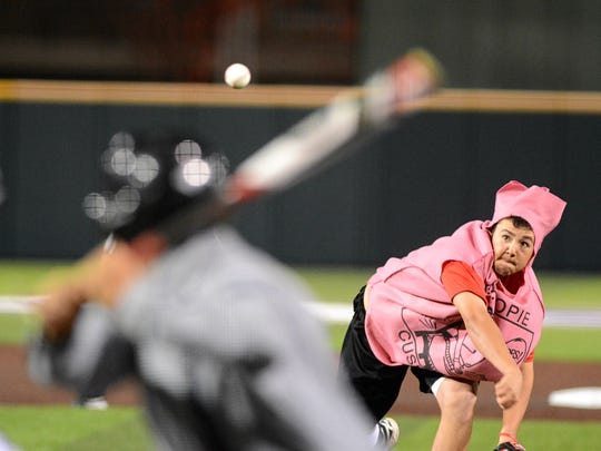 Cooper's Andrew Gomez, dressed as a whoopee cushion throws a pitch during a costume scrimmage between the Abilene High and Cooper baseball teams Monday at Abilene Christian University's Crutcher Scott Field.