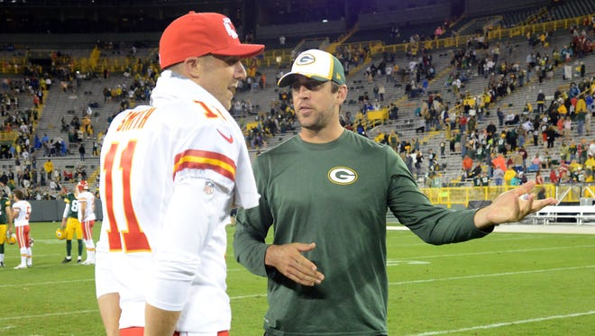 Green Bay Packers quarterback Aaron Rodgers, right, chats with quarterback Alex Smith (11) after the game against the Kansas City Chiefs at Lambeau Field.
