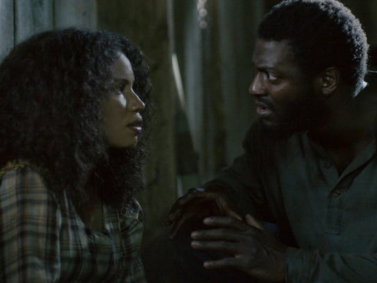 Jurnee Smollett-Bell, left, and Aldis Hodge star in