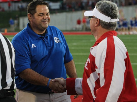 Simon Kenton head coach Jeff Marksberry shakes hands with Beechwood head coach Noel Rash prior to their game at Beechwood, Friday, September 29, 2017.