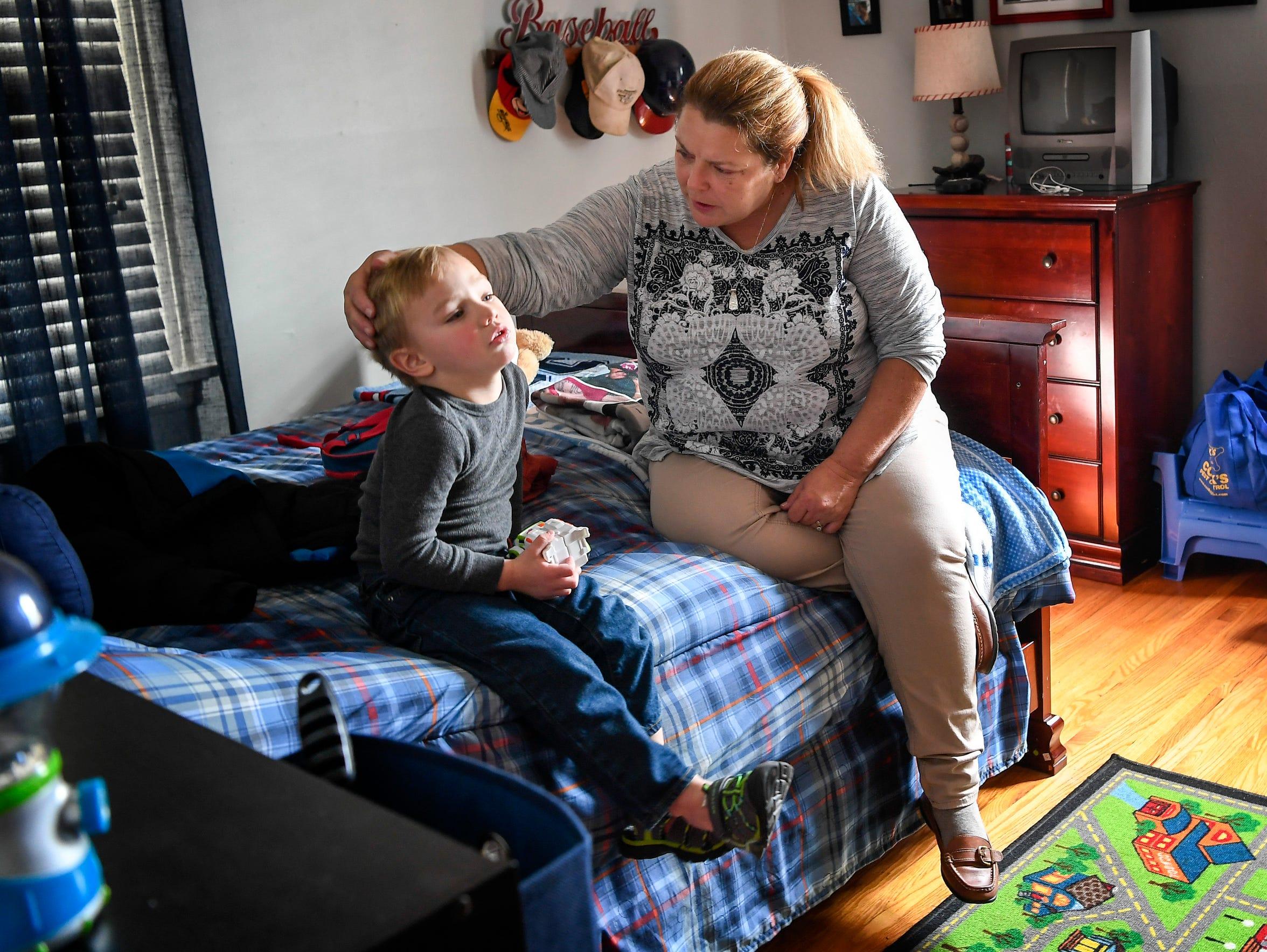 Tina Baltz tries to comfort her grandson, 4-year-old