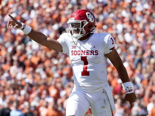 Oct 12, 2019; Dallas, TX, USA; Oklahoma Sooners quarterback Jalen Hurts (1) reacts after throwing a touchdown pass during the second half against the Texas Longhorns at the Cotton Bowl. Mandatory Credit: Kevin Jairaj-USA TODAY Sports ORG XMIT: USATSI-404205 ORIG FILE ID:  20191012_krj_aj6_0059.JPG