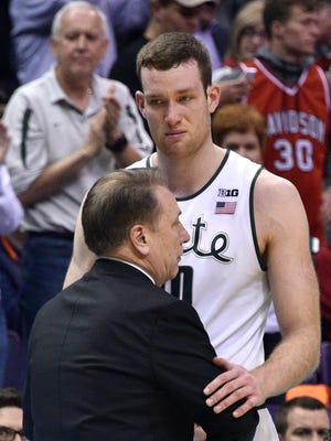 An emotional Matt Costello pauses to hug Tom Izzo as MSU falls Friday to Middle Tennessee, 90-81 in the first round of the NCAA men's basketball tournament
