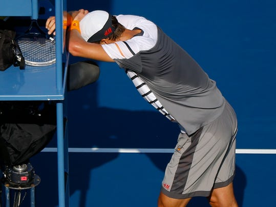 Tomas Berdych, of the Czech Republic, reacts after the chair umpire ruled that a ball hit by Marin Cilic, of Croatia, bounced twice before hitting Berdych's racket during the quarterfinals of the 2014 U.S. Open tennis tournament, Thursday, Sept. 4, 2014, in New York. (AP Photo/Seth Wenig)