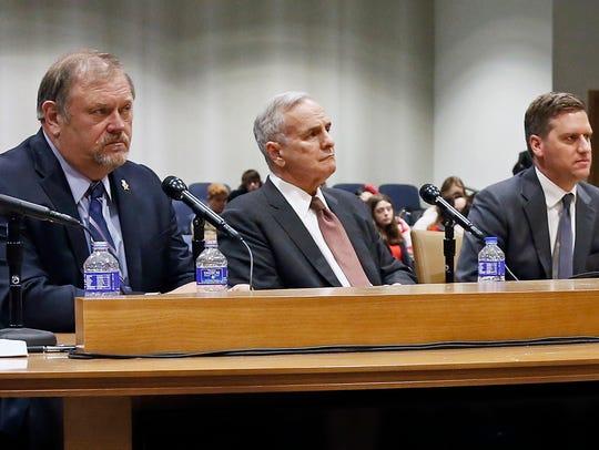 Minnesota Gov. Mark Dayton, center, sits between Senate