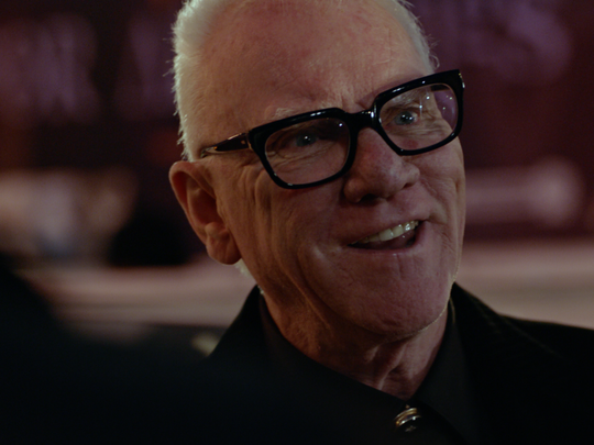 "Malcolm McDowell, seen in a scene from ""American Satan."""