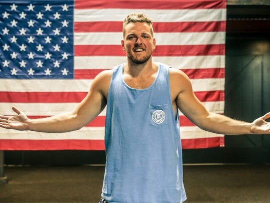 Former Colts punter Pat McAfee stands in front of a