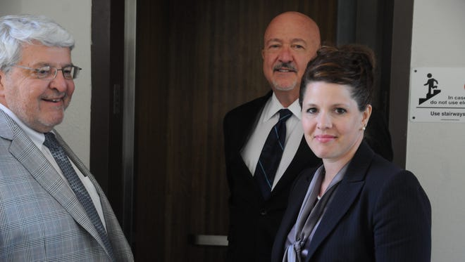 Former Republican political candidate Annette Bosworth, right, stands with her attorneys Dana Hanna, center, and Bob Van Norman, left, during a break in her trial May 21 outside of the courtroom in Pierre.