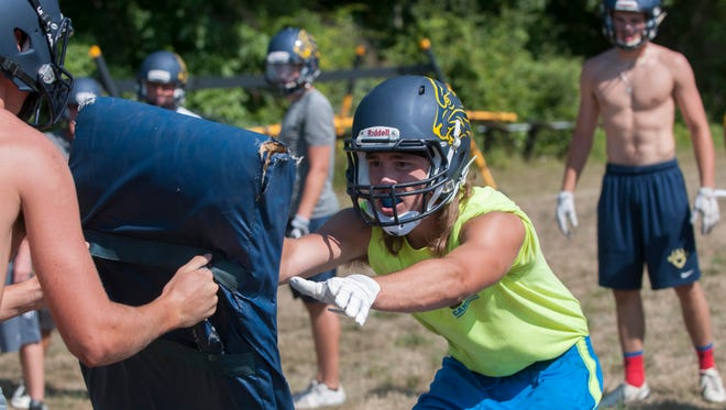 Algonac's Dylan Jack pushes on a bag Wednesday, Aug. 10 , 2016 during a drill at their football practice at Algonac High School.