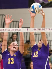 UWSP's Alexis Hartman, left, and Emma Brunkhorst go up for a block against UW-Eau Claire.