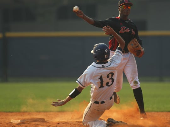 NFC shortstop Brandon Walker tries to turn a double play as Maclay's Ben Sharkey slides into second base.