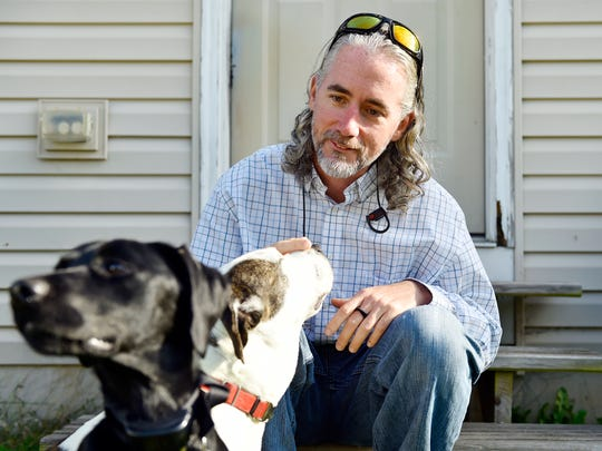 Budhi Blair relies on his service dog Ryder, left, to help him cope with his PTSD. He had a run-in with a vendor at Central Market that illustrates that there is some confusion over the law governing such animals.