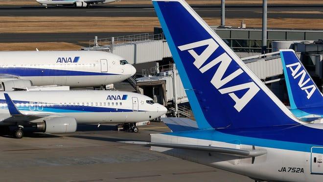 Nippon Airways (ANA) passenger planes park at Haneda Airport in Tokyo.