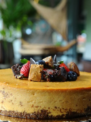 A pumpkin cheesecake, topped with chocolate, fresh fruit pieces, along with brownie and blondie cubes, is seen after being prepared at the Proa Restaurant in Hagatna on Friday, Sept. 11.